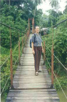The author on a bridge leading to town