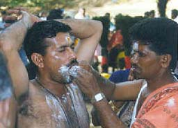 devotee has his cheeks pierced by a miniature spear