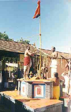 Flag-hoisting at Teyvanai Amman Kovil [12 kb]