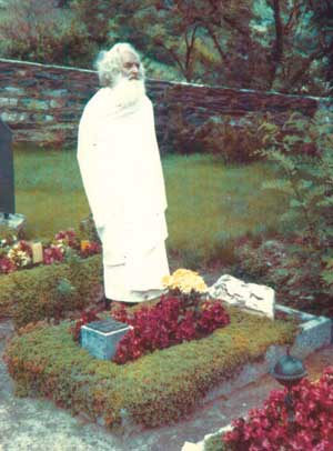 German Swami Gauribala paying respects at the grave of his first mentor, the German poet Stefan George, in Switzerland in the mid-1970's